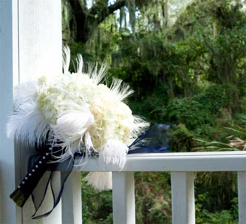 Scarlett 39s lovely wedding bouquet using white peacock feathers and ostrich